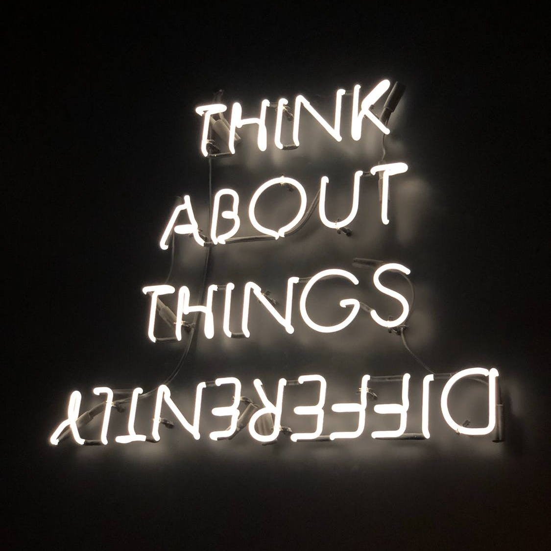 Think about things differently sign
